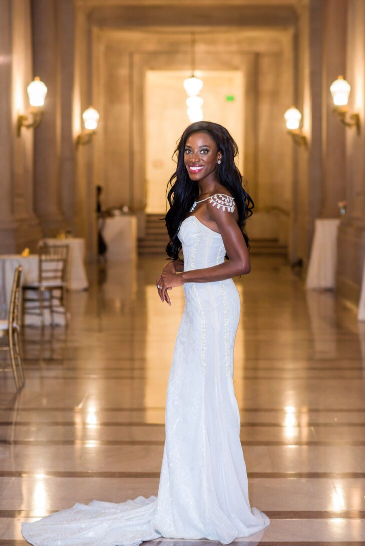 Beth removed the tulle train of her Galia Lahav dress for the reception, turning the eye-catching gown into a sleek dress for dinner and dancing. To add a hint of sparkle, she donned Swarovski crystal shoulder jewelry.