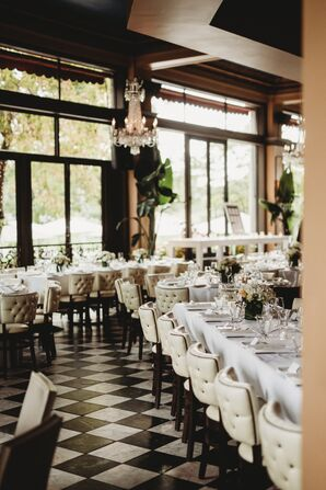 Restaurant Reception Decorated with Greenery and Black-and-White Accents
