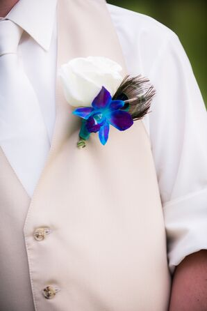 Blue Orchid and Peacock Feather Boutonniere