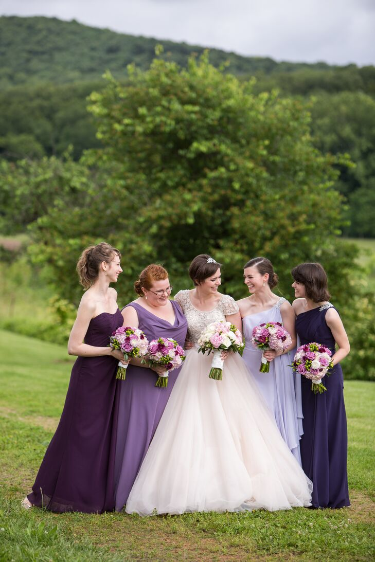 Having always loved the mismatched look for bridesmaid dresses, Haley decided that's exactly what she wanted. Her two maids of honor wore one-shoulder dresses with a sparkly applique to help them stand out while the other ladies wore different necklines. Each was a different shade of purple for a cohesive but casual look.