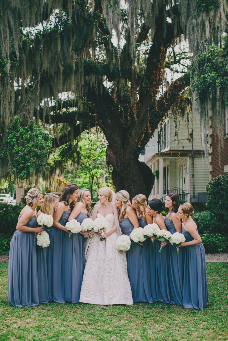 The bridesmaids wore floor-length gray dresses from the Dessy Group. Kinsey and Collins loved how the dresses matched the neutral color palette and looked fabulous on each of the bridesmaids.