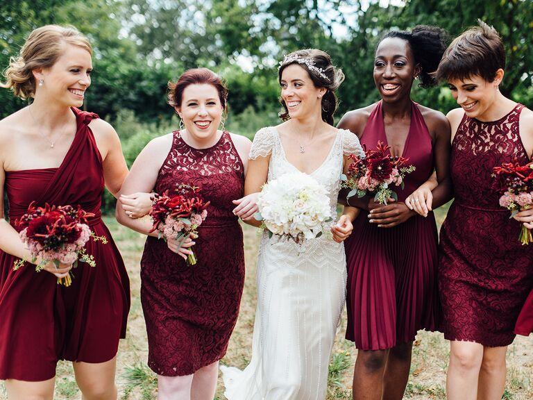 Mismatched Bridesmaid Dresses In Burgundy With Bride White Cap Sleeved Dress