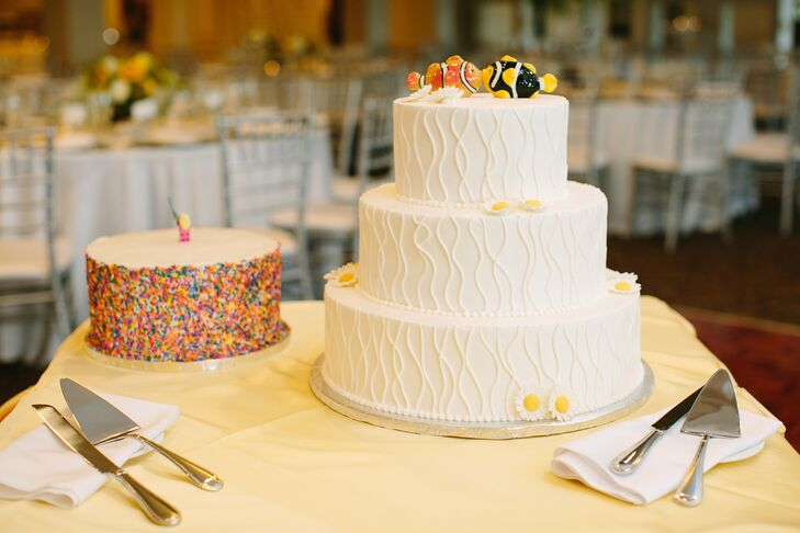 Wedding Cake with Fish Cake Toppers and a Groom's Cake with Sprinkles