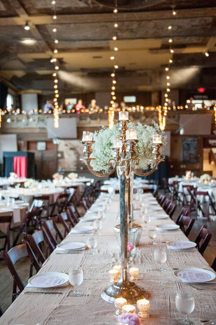 Tall candelabra and baby's breath arrangements added dimension to the reception decor.