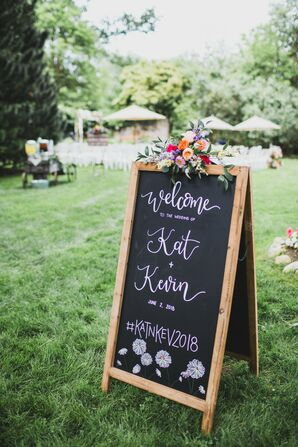 Chalkboard Welcome Sign with Drawn Flowers and Summer Floral Arrangement