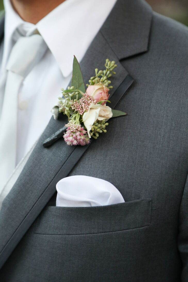 Sean had a pink and ivory rose boutonniere accented with green pinned to his jacket.