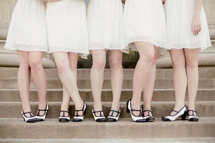The bridesmaids wore black-and-white shoes to match the Hollywood theme of the wedding.