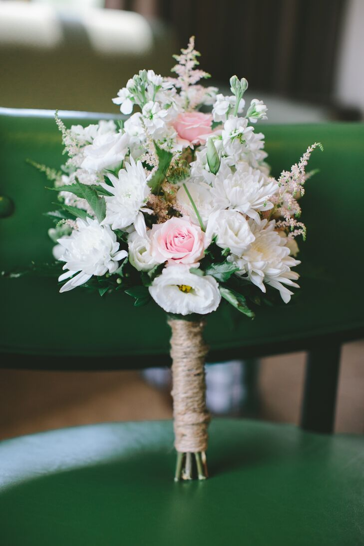 Meghan found a her favorite floral arrangement on Pinterest, and took a photo to her florist. He did an amazing job re-creating the look for her. He combined white dahlias, white lisianthus, white astilbes and blush roses for a textured look. The stems were tied with twine for a little rustic flair.