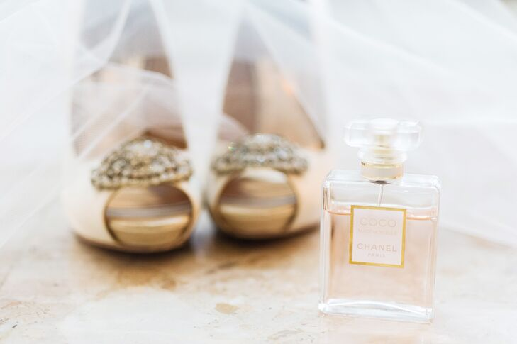 "To complement her ivory Watters wedding dress ,the bride opted for a pair of Badgley Mischka heels. ""I wore the tallest shoes I could stand! There's never enough heigh for a short girl like me!"""