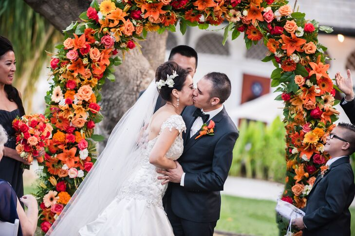 """""""There was an arch that we wanted to be decorated with the orange flowers. It turned out better than what we had in mind.  It was full and bright, bursting with the orange flowers,"""" says Chantley."""