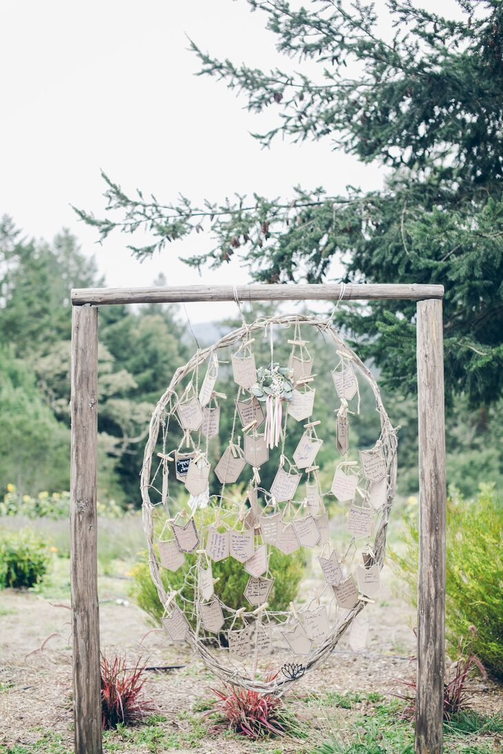Guests wrote their hopes and dreams for Jayme and Jeremy's future on pieces of paper, then attached them to the large dream catcher made of wood for them to hold onto.
