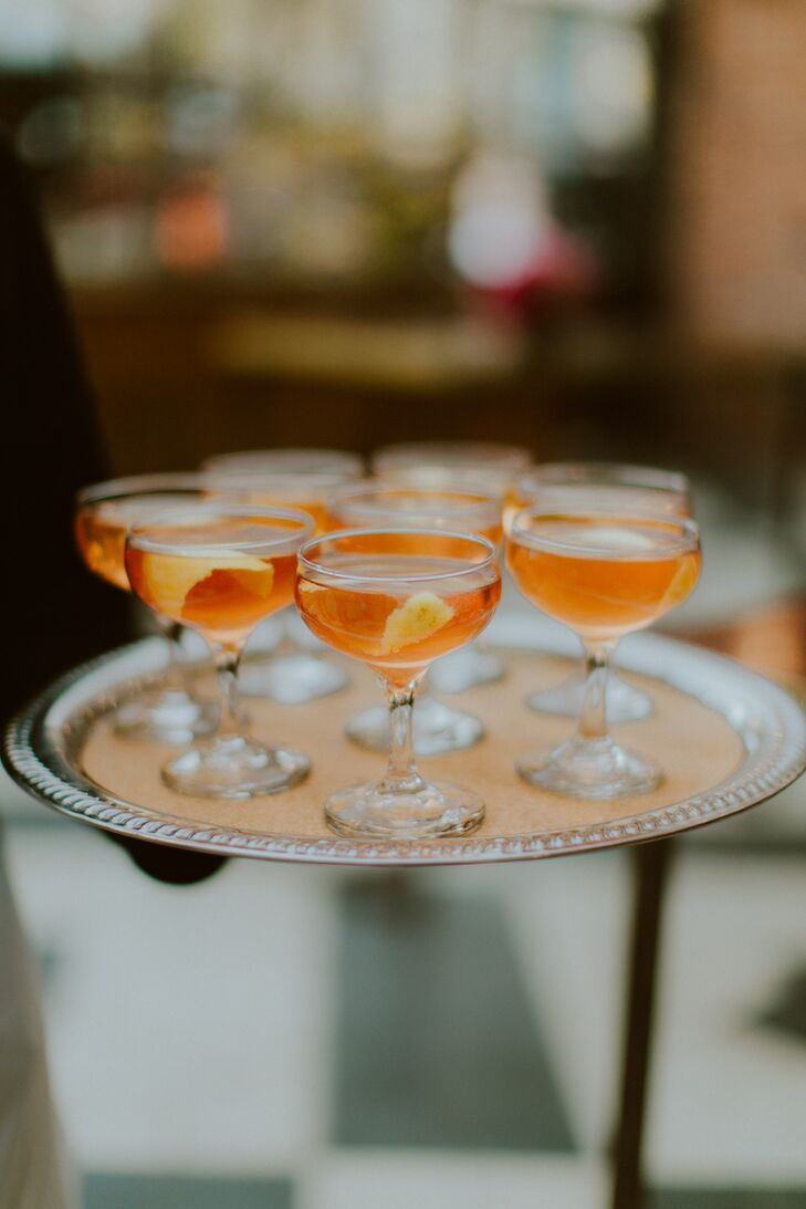 Before sitting down to dinner, the newlyweds and their guests mixed, mingled and sipped on signature drinks, including champagne cocktails, daiquiris and old-fashioneds. For a hint of old-world glamour, the drinks were served in vintage-inspired coupes set on silver trays.