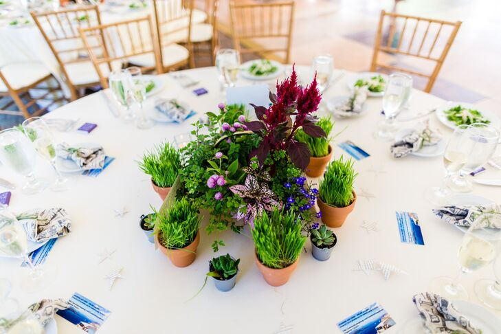 Instead of standard arrangements of romantic blooms, Adrienne did things a little differently when it came to the centerpieces. Playing off the reception's Love Park theme, she planted grasses, herbs, succulents and wildflowers in terra-cotta and metal pots and placed them in clusters on each table.