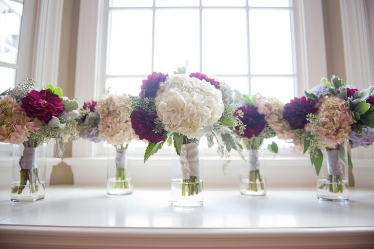 Marlee and her bridesmaids carried bouquets with white, powder blue and blush hydrangeas, dusty miller and red dahlias.