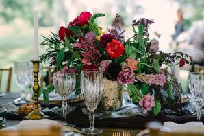 Deep Red and Purple Flower Centerpiece in Gold Vase