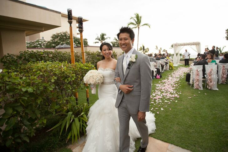 The bride's mermaid-style wedding gown featured a tiered lace skirt and beaded embellishments.