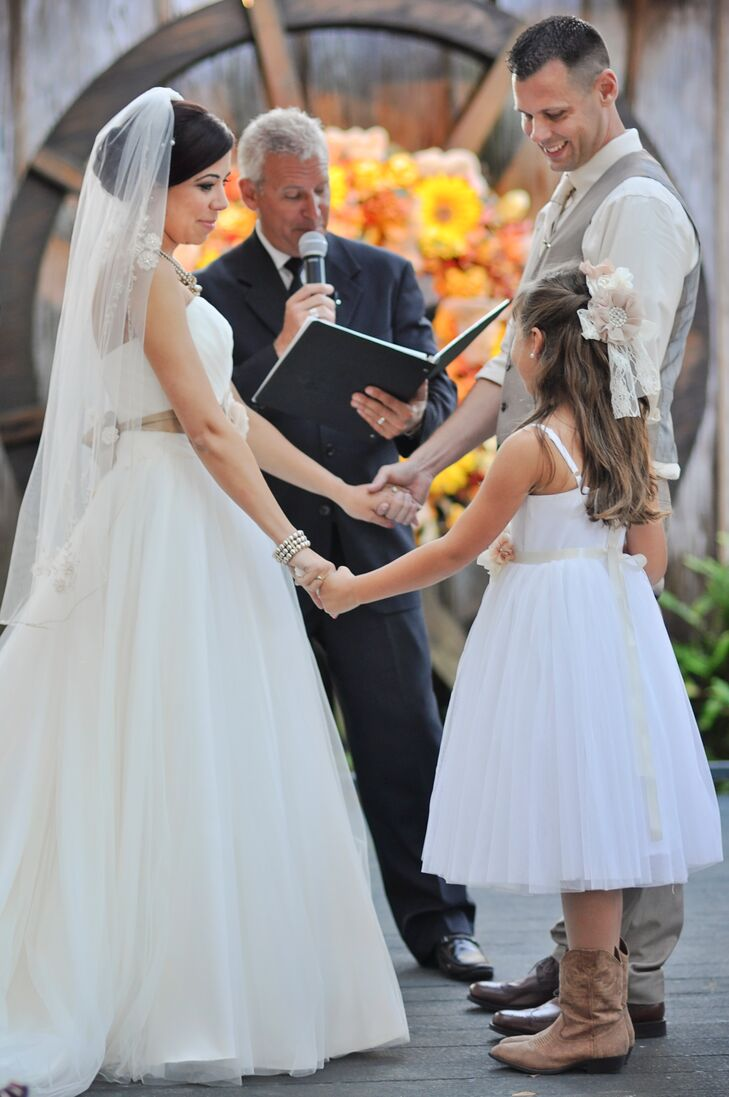 """""""Having Jeremy's daughter included in our ceremony was the biggest thing,"""" Heather says. """"After we said our vows, the officiant called Emma up to us. She and I did our own vows and Jeremy had a special speech prepared for Emma. There wasn't a dry eye in the house. Thank God for waterproof mascara!"""""""