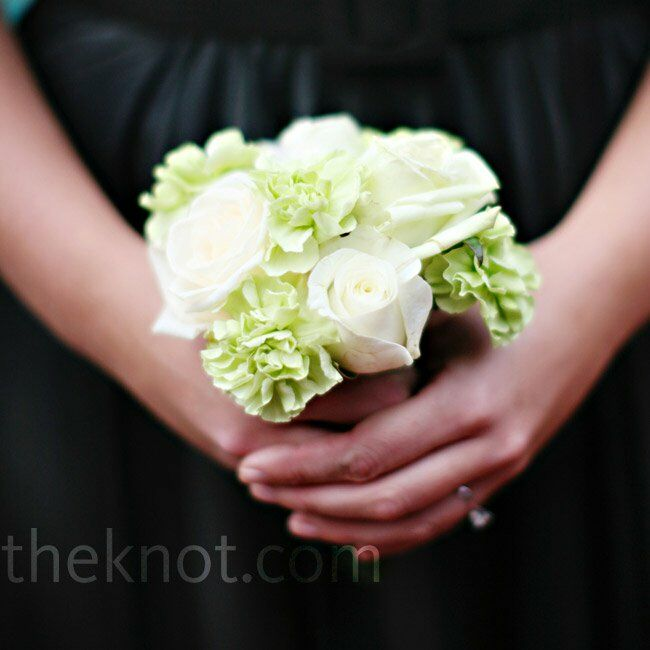The bridesmaids carried white DIY mini-bouquets of roses, hydrangeas, and green carnations.