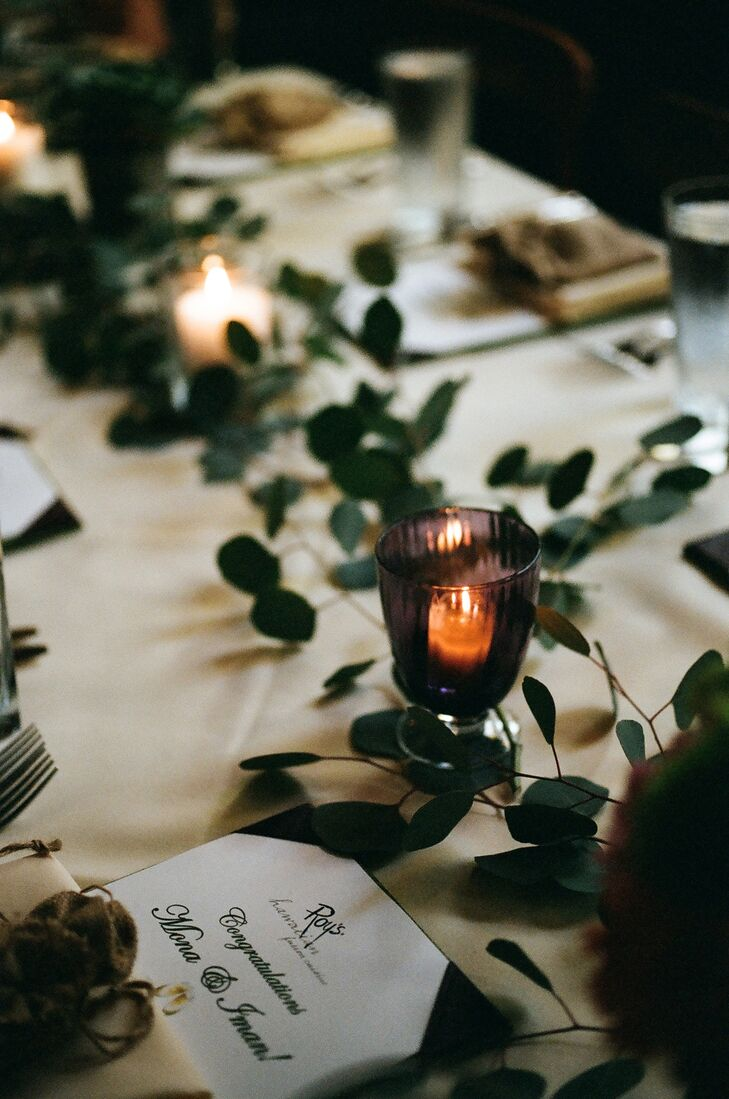 Guests were served rounds of appetizers and food at the romantically decorated dinner tables. Each place setting had a customized menu congratulating the bride and groom.