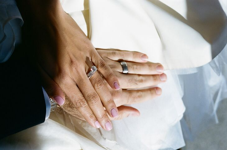 The Bride and Groom Showing Off their Rings