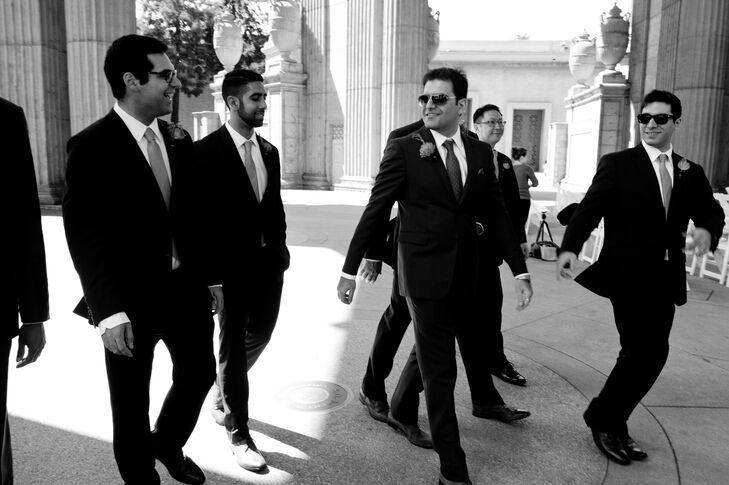 The Groom Walking with his Groomsmen