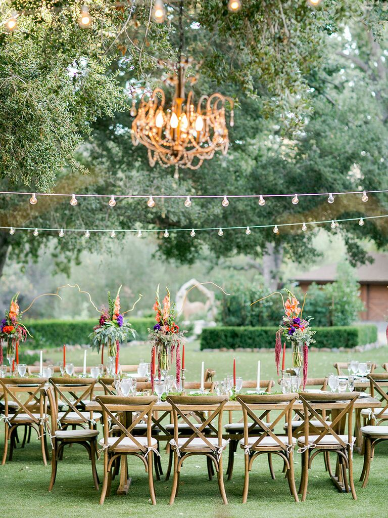 Outdoor chandelier in trees rustic