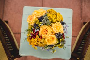 Gold Floral Arrangement with Greens and Reds