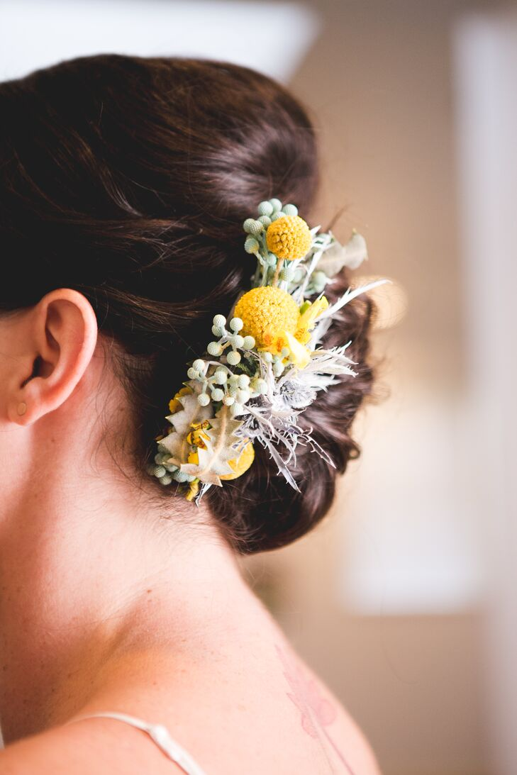 Stephanie wore craspedia and thistles in her hair to match the wedding flowers.