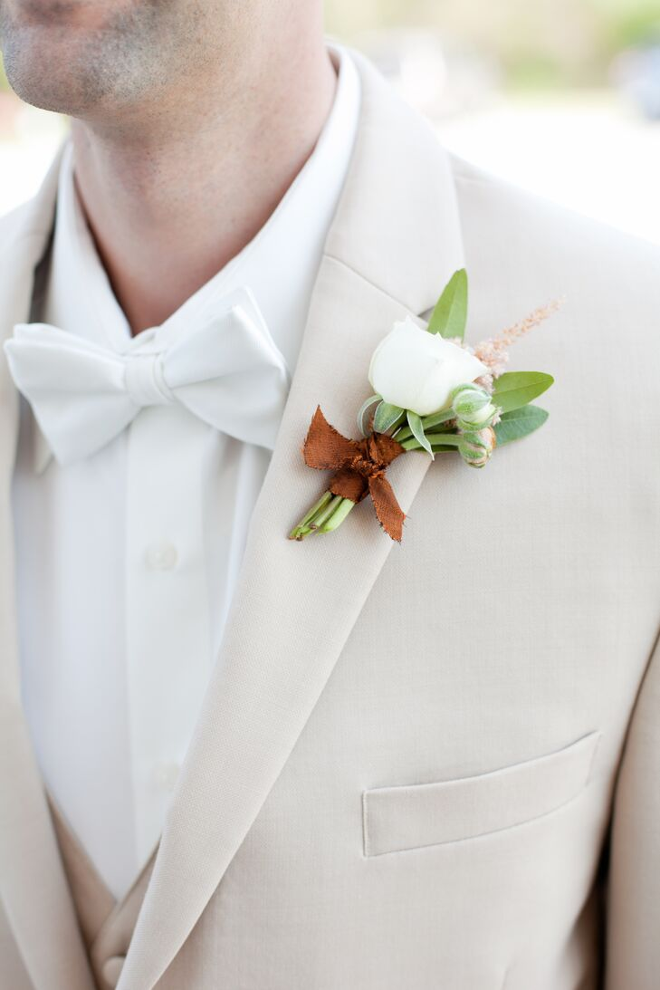 Tan Suit with White Bow Tie and Boutonniere