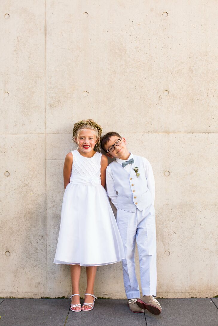 The flower girl wore a simple white dress while the ring bearer wore a gray vest with matching pants and bow tie.