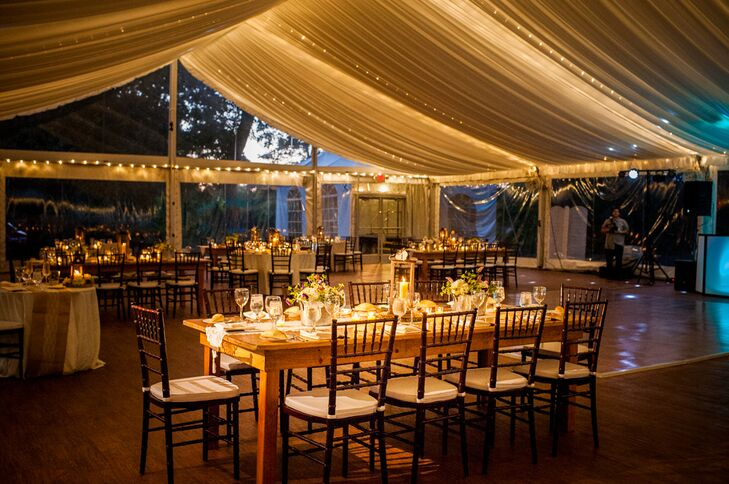 The reception was held under a permanent tent that featured windows allowing guests to enjoy beautiful views of the Delaware River. The tent's canopy twinkled with string lights that illuminated the farmhouse dining tables and brown chiavari chairs.