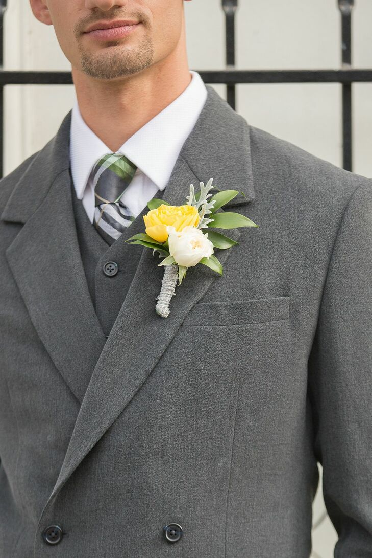 DJ had an ivory and yellow rose boutonniere pinned to his gray suit jacket.