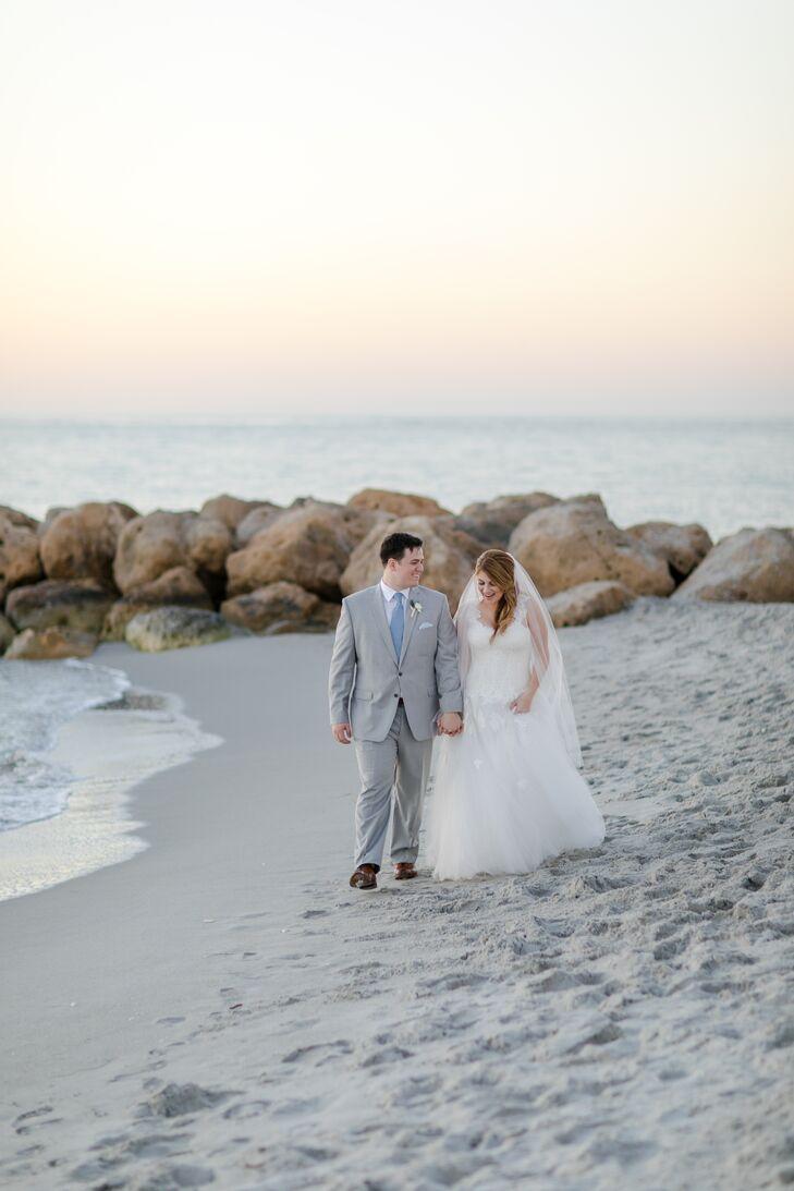 Bride and Groom Stroll Along Beach