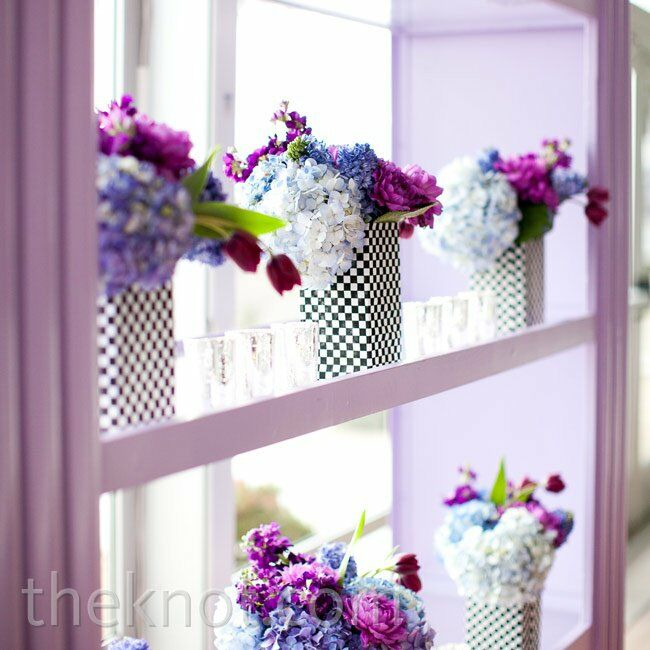 Staying true to the modern look, colorful flowers topped checkered vases.