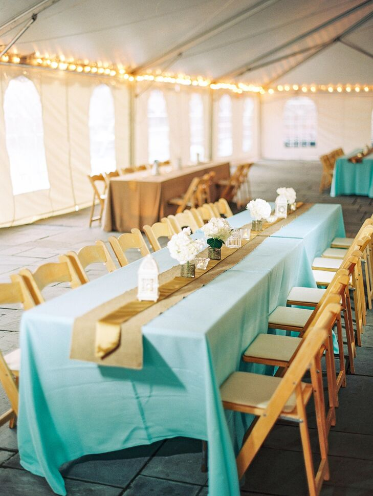 The tented reception was decorated simply with string lights and farmhouse dining tables covered in mint tablecloths.