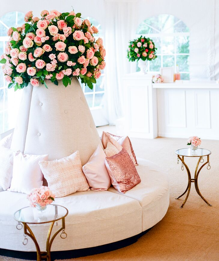 A plush sette adorned with rose gold and blush pillows provided a luxurious place for guests to sit and enjoy cocktails.