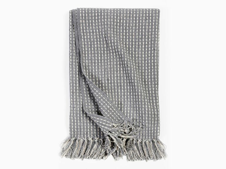 gray patterned throw blanket with tassels
