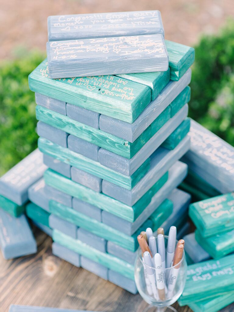 Creative guest book alternative using blue Jenga blocks - wedding details not to miss