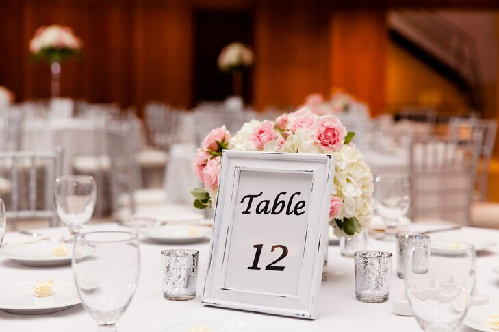 The newlyweds chose simple black and white table numbers in frames to let guests know where to sit.