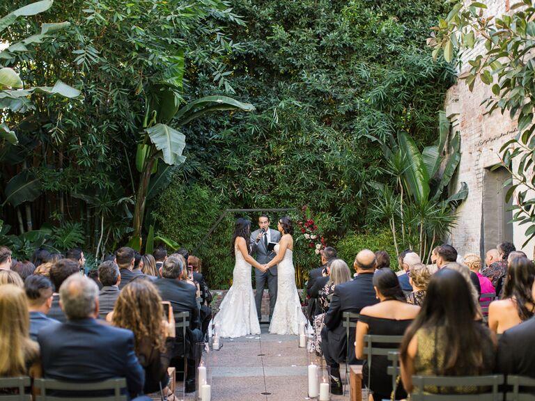 Brides reciting vows at wedding ceremony