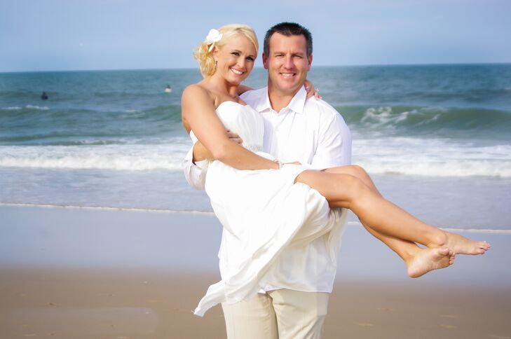"""Amanda and Jason were married on Croatan Beach in Virginia Beach, Virginia. """"We were right on the ocean with surfers in the background, and the weather was perfect,"""" Amanda says."""