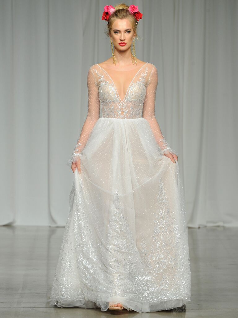 Julie Vino Spring 2019 A-line wedding dress with a plunging neckline and sheer illusion long sleeves