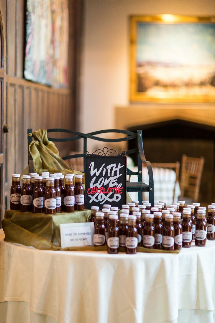 Liz and Ryan gave their guests a taste of the South with bottles of barbecue sauce from Charlotte, North Carolina, as their wedding favors.