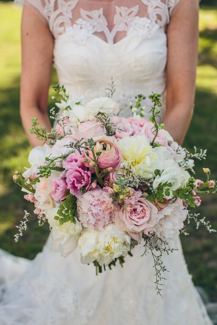 """""""The flowers were gorgeous,"""" Heather says. """"Justin of JW Events and Sara from Sara Cavallon Celebrations worked together to create the vision we were looking for, something between English garden and perfectly elegant."""" Heather carried ranunculus, roses, garden roses, peonies, dahlias, stock and greenery in her lush, textured bouquet."""