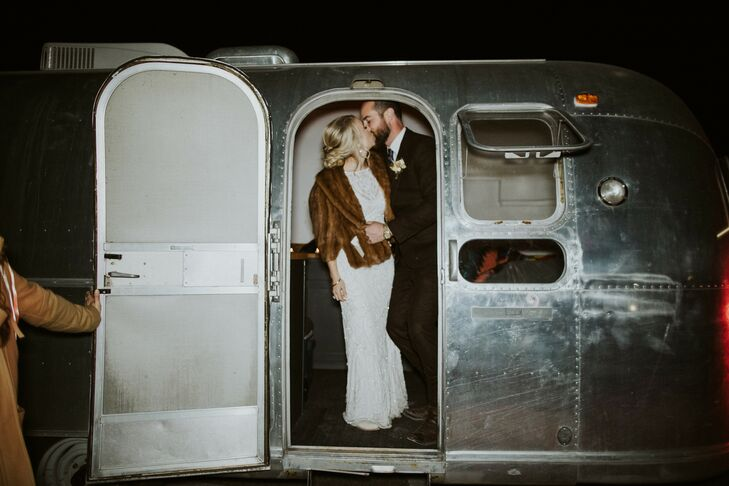 Couple Shares Kiss in Airstream Trailer at Texas Wedding
