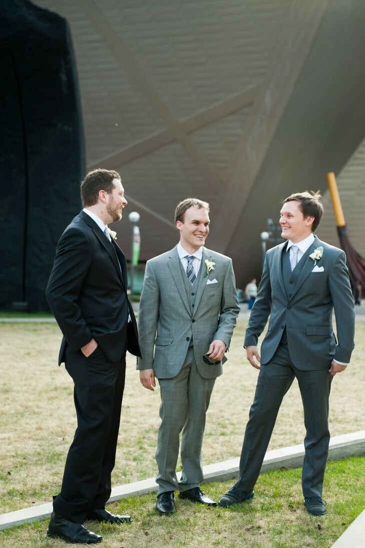 Corey wore a gray three-pieces suit with a gray-and-white plaid tie. His groomsmen wore gray suits in whichever shade of gray they preferred.