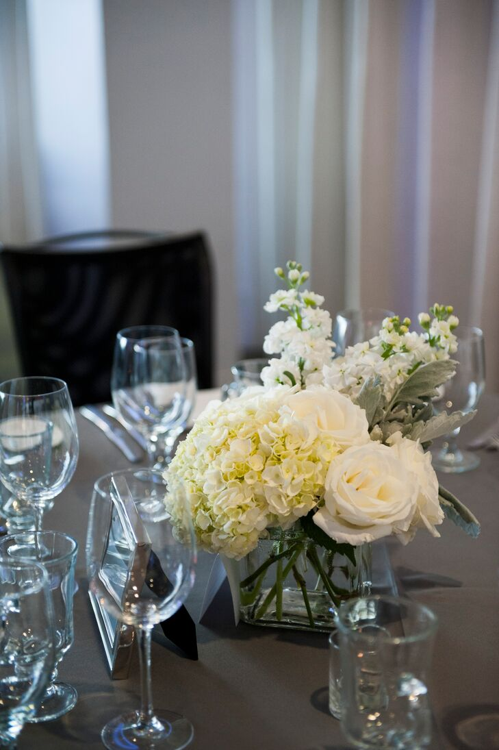 The reception tables were decorated with square glass vases holding white hydrangeas, roses and lily of the valley.