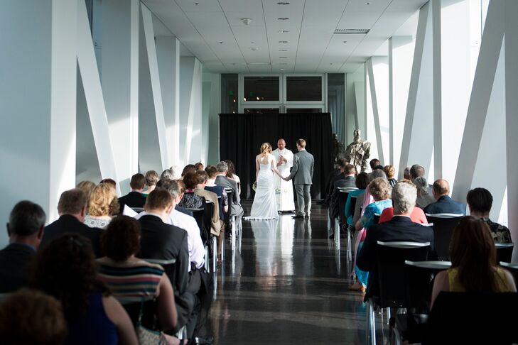 """""""We chose the museum because throughout our relationship most of our favorite dates have been at museums,"""" Marla says. """"We rented a portion of the museum that included a glass-enclosed bridge where we held the ceremony."""""""