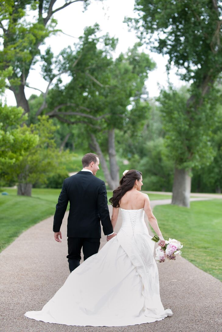Caitlin wore an A-line Martina Liana wedding dress with a corset back and chapel-length train from Mariee Bridal.
