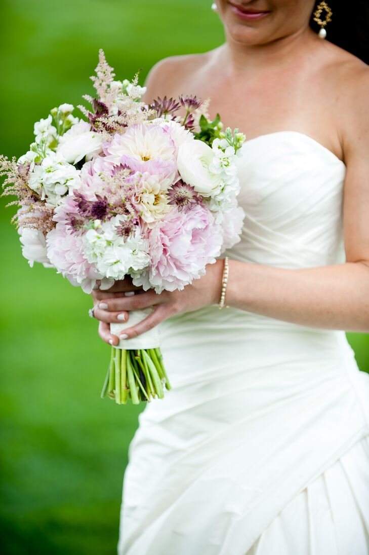 Caitlin carried dahlias, hydrangeas, ranunculuses and peonies in her pink, plum and white bouquet.